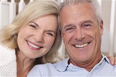 Happy Couple With Dental Implants In Birmingham Alabama